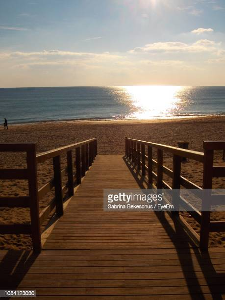 pier on sea - alvor stock pictures, royalty-free photos & images