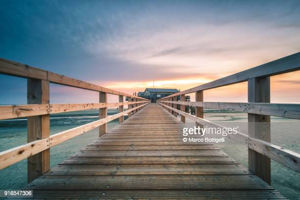pier on the beach, north frisia, germany. - desaparecidos imagens e fotografias de stock