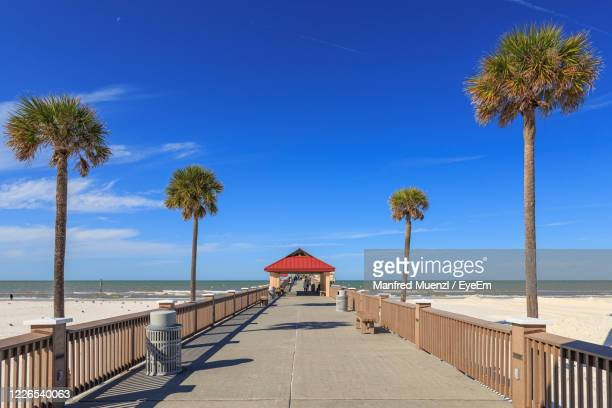 pier on the beaches of clearwater beach - clearwater florida stock pictures, royalty-free photos & images