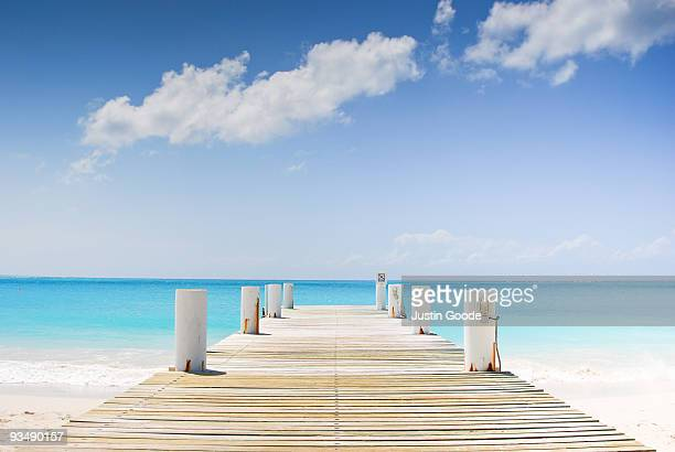 pier on turks and caicos - turks and caicos islands stock pictures, royalty-free photos & images