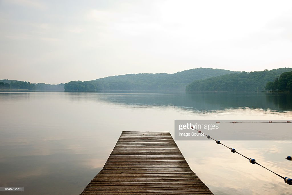 Pier onto calm lake, Bear Mountain, NY, USA : Stock Photo