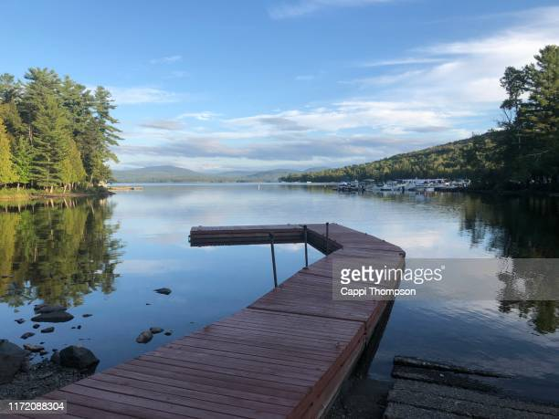 pier or boat dock at lake mooselookmeguntic in rangeley, maine usa - mooselookmeguntic lake - fotografias e filmes do acervo