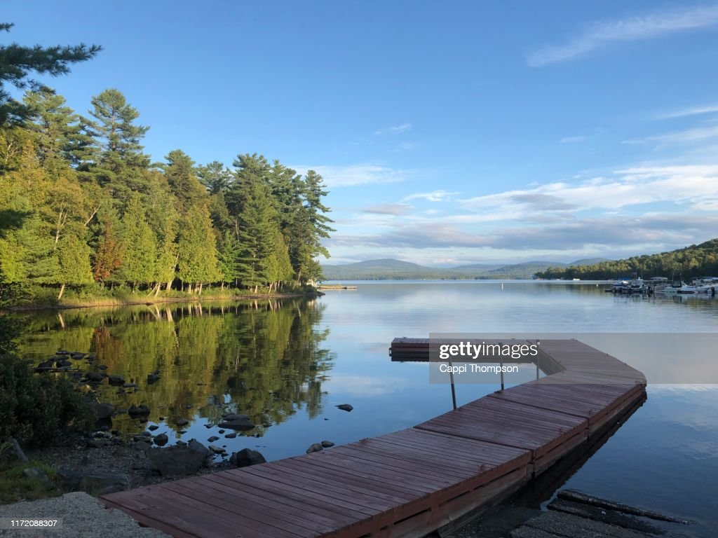 Pier or boat dock at lake Mooselookmeguntic in Rangeley, Maine USA : Stock Photo