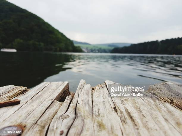 pier over lake against clear sky - pier stock pictures, royalty-free photos & images