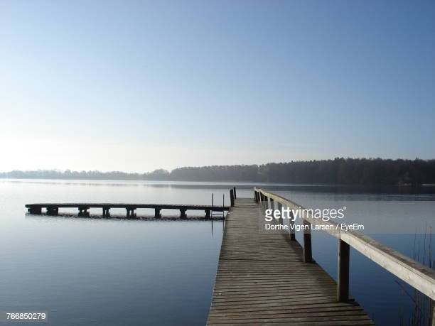 Pier Over Lake Against Clear Sky