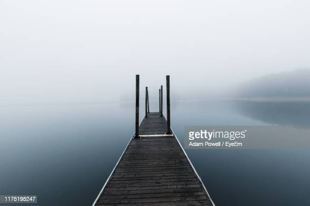 pier over lake against sky - columbia south carolina stock pictures, royalty-free photos & images