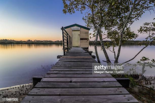 pier over lake against sky - mooloolaba stock pictures, royalty-free photos & images