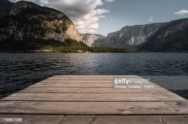 pier over lake against sky - christian soldatke stock pictures, royalty-free photos & images