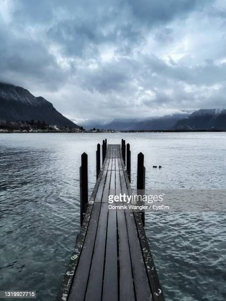 pier over lake against sky - montreux stock pictures, royalty-free photos & images