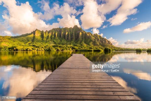 pier over lake against sky - oahu stock pictures, royalty-free photos & images
