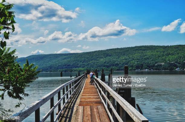 pier over lake against sky - westchester county stock pictures, royalty-free photos & images