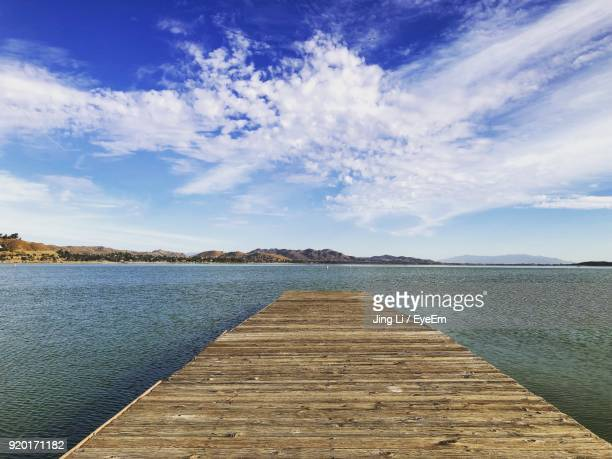 pier over lake against sky - lake elsinore stock photos and pictures
