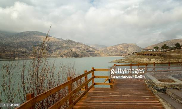 pier over lake against sky - central anatolia stock photos and pictures