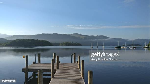 pier over lake against sky - keswick stock pictures, royalty-free photos & images