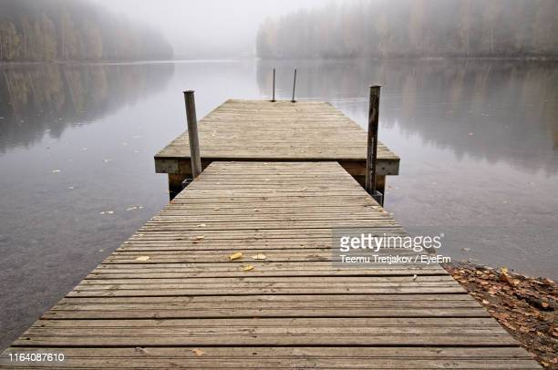 pier over lake - teemu tretjakov stock pictures, royalty-free photos & images
