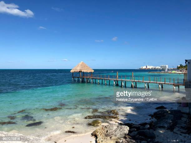 pier over sea against blue sky - quintana roo stock pictures, royalty-free photos & images