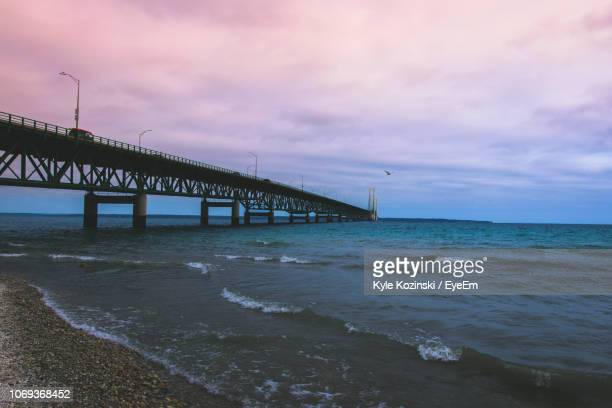 pier over sea against sky during sunset - mackinac island stock pictures, royalty-free photos & images