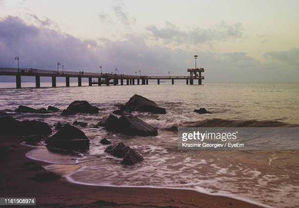 pier over sea against sky during sunset - krasimir georgiev stock photos and pictures