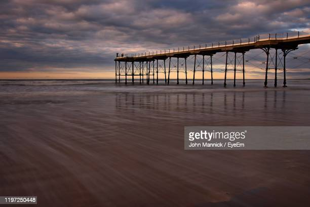 pier over sea against sky during sunset - saltburn stock pictures, royalty-free photos & images