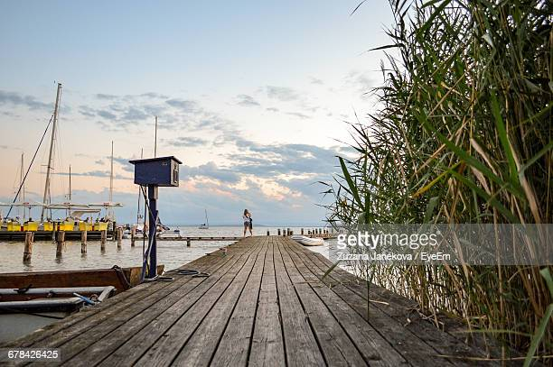 pier over sea against sky during sunset - zuzana janekova stock pictures, royalty-free photos & images