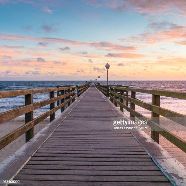 pier over sea against sky during sunset - ウセドム ストックフォトと画像