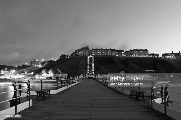 pier over sea against sky in city - north yorkshire stock pictures, royalty-free photos & images