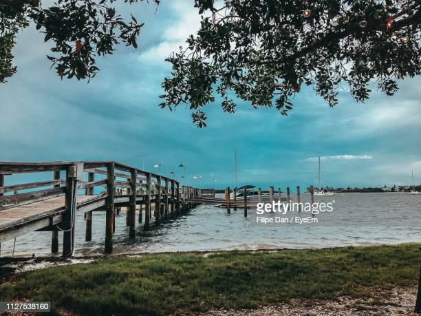 pier over sea against sky - sarasota stock pictures, royalty-free photos & images