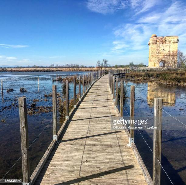 pier over sea against sky - gard stock photos and pictures