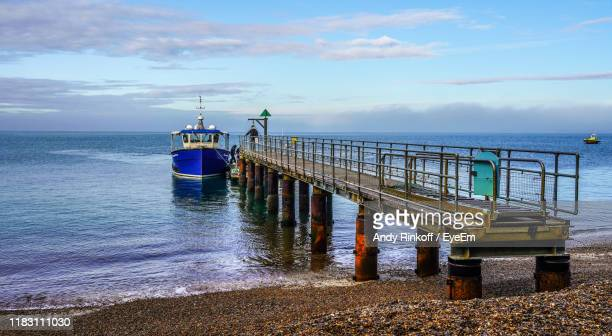 pier over sea against sky - andy rinkoff stock pictures, royalty-free photos & images