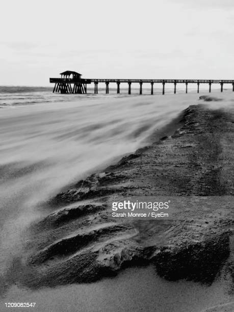 pier over sea against sky - sarah sands stock pictures, royalty-free photos & images