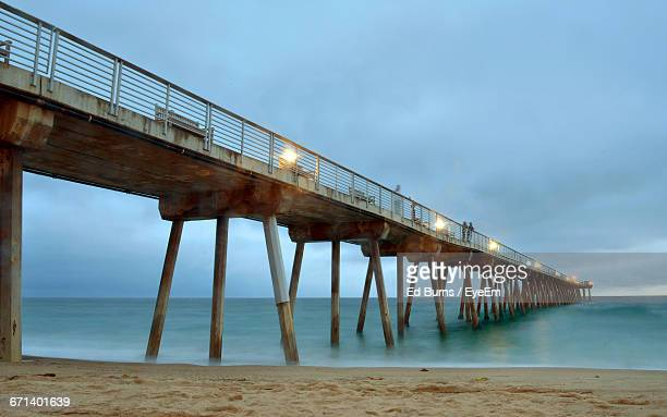 pier over sea against sky - hermosa beach stock pictures, royalty-free photos & images