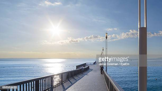 pier over sea against sky - jesse coleman stock pictures, royalty-free photos & images