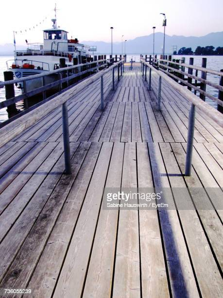 pier over sea against sky - sabine hauswirth stock pictures, royalty-free photos & images
