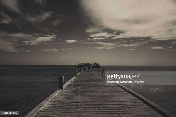pier over sea against sky - anna maria island stock pictures, royalty-free photos & images