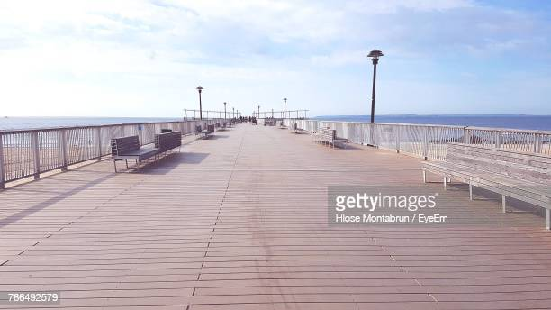 pier over sea against sky - coney island stock pictures, royalty-free photos & images