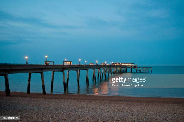 pier over sea against sky - deal england stock photos and pictures