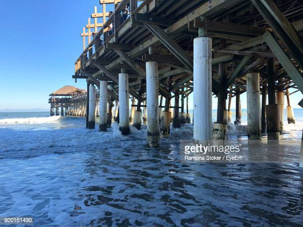 pier over sea against sky - cocoa beach stock pictures, royalty-free photos & images