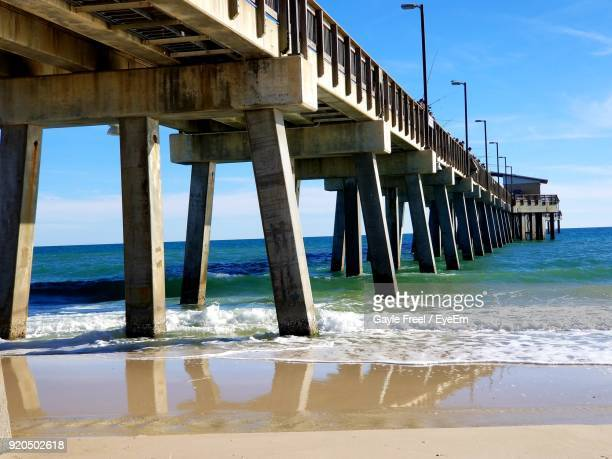 pier over sea against sky - gulf shores alabama stock pictures, royalty-free photos & images