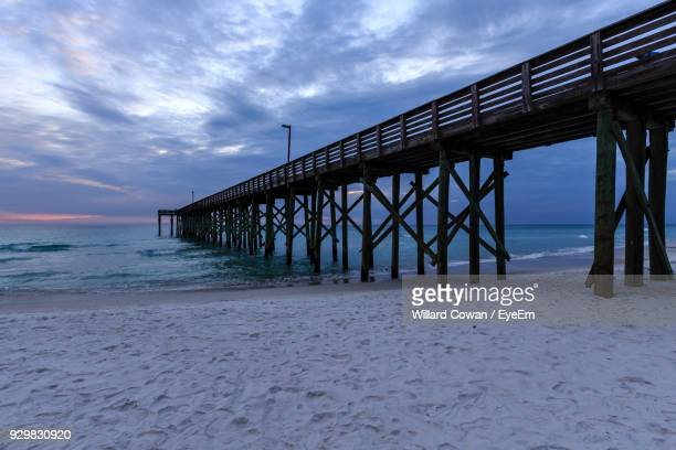 pier over sea against sky - panama city beach stock pictures, royalty-free photos & images