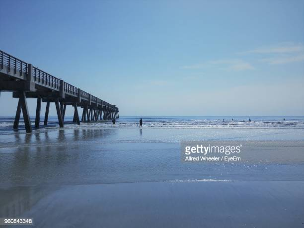pier over sea against sky - jacksonville beach stock pictures, royalty-free photos & images