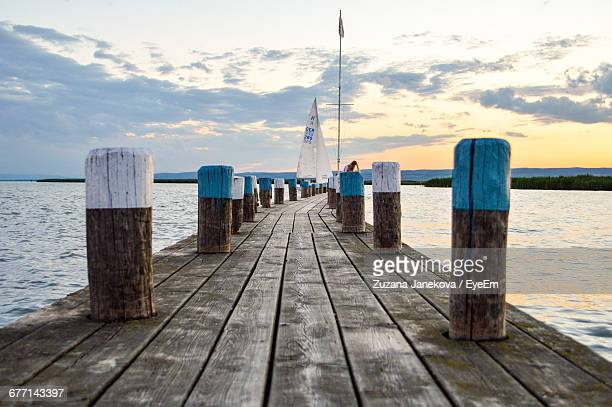 pier over sea at sunset - zuzana janekova stock pictures, royalty-free photos & images