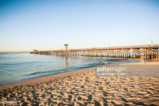 pier over sea - seal beach stock pictures, royalty-free photos & images