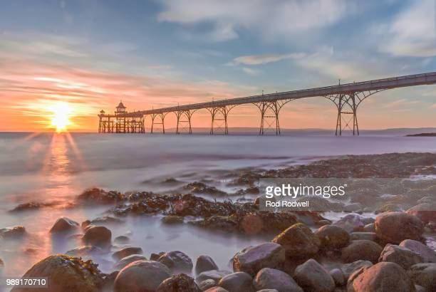 pier sunset - clevedon pier stock pictures, royalty-free photos & images