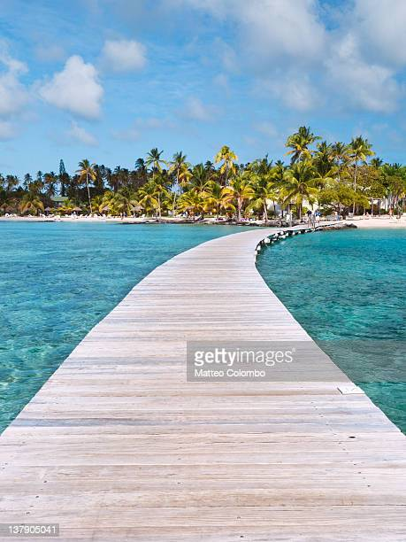 pier to tropical island - martinique stock photos and pictures