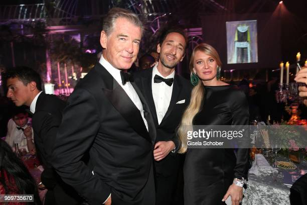 Pierce Brosnan Adrien Brody and buyer of the painting attend the amfAR Gala Cannes 2018 dinner at Hotel du CapEdenRoc on May 17 2018 in Cap d'Antibes...