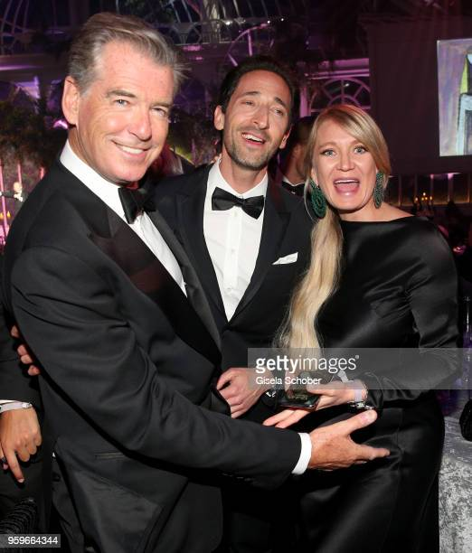 Pierce Brosnan Adrien Brody and guest attend the amfAR Gala Cannes 2018 dinner at Hotel du CapEdenRoc on May 17 2018 in Cap d'Antibes France