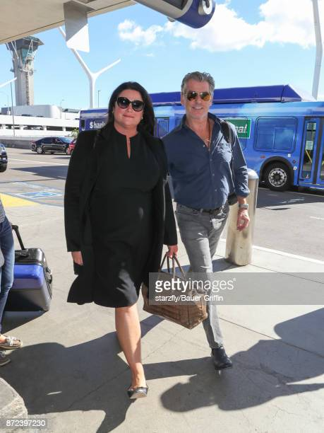 Pierce Brosnan and his wife Keely Shaye Smith are seen at Los Angeles International Airport on November 09 2017 in Los Angeles California