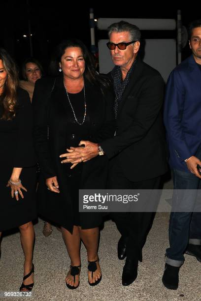 Pierce Brosnan and his wife Keely Shaye Smith arrive at a party in Port Canto during the 71st annual Cannes Film Festival at on May 16 2018 in Cannes...