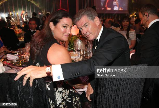 Pierce Brosnan and his wife Keely Shaye Smith during the amfAR Gala Cannes 2018 dinner at Hotel du CapEdenRoc on May 17 2018 in Cap d'Antibes France