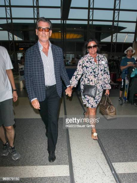 Pierce Brosnan and Keely Shaye Brosnan are seen at Los Angeles International Airport on July 07 2018 in Los Angeles California